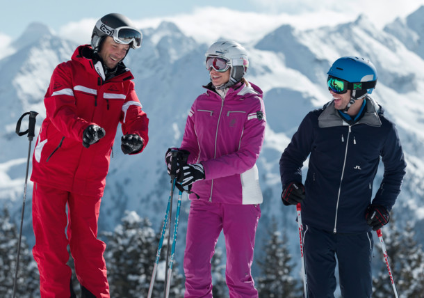 Two skiiers with a ski instructor in the Schladming ski area